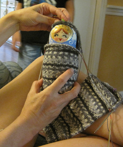 Julie with a nesting doll in her sock