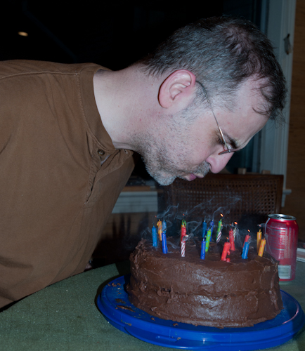 Richard blowing out candles