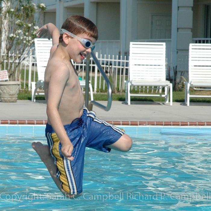 douglas jumping in pool