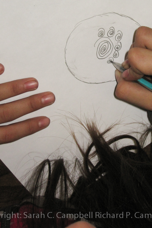 A starting her drawing on watercolor paper.