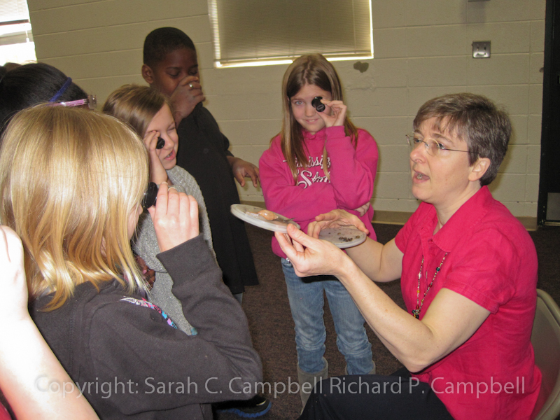 sarah campbell showing wolfsnails to saltillo students