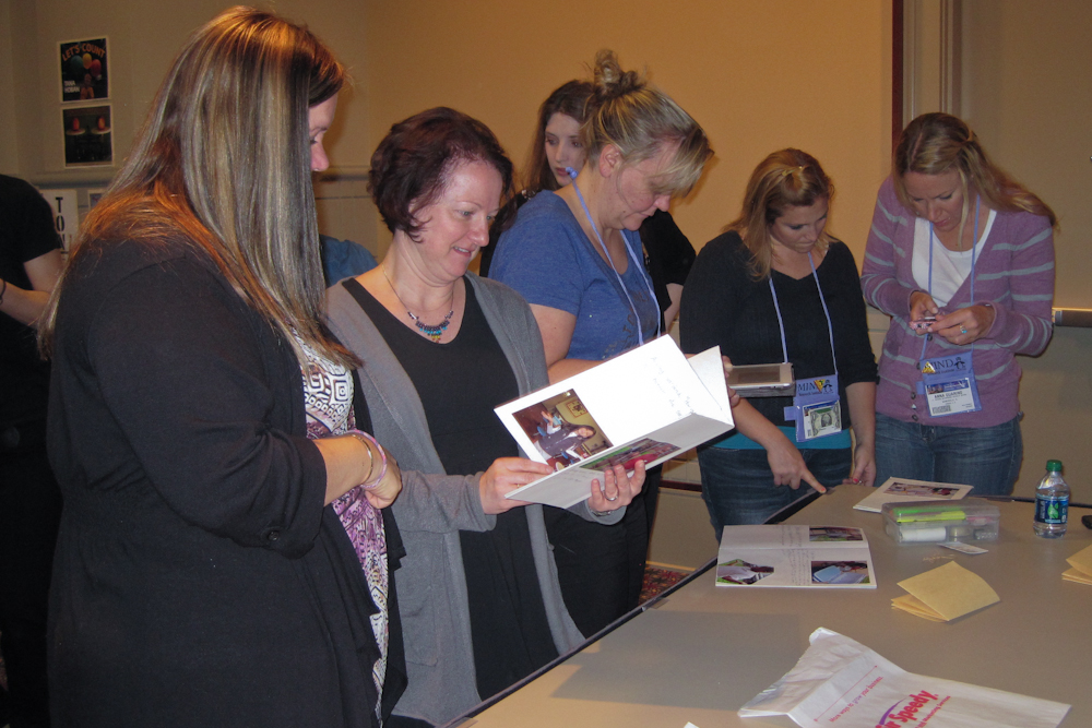 teachers reviewing sample books