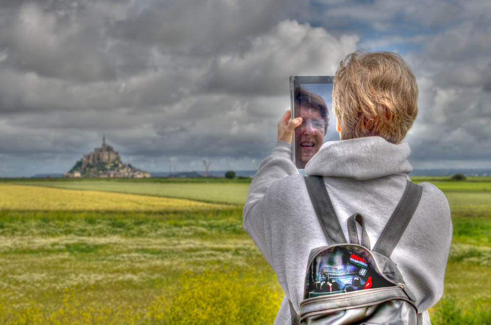 sarah using ipad to photograph mt st michel